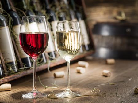 Wine bottles on the wooden shelf.