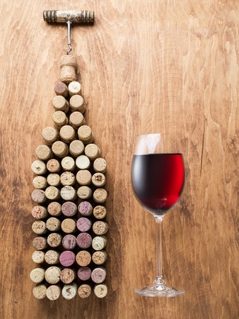 wine tasting: Wine corks in the shape of wine bottle on the wooden background.
