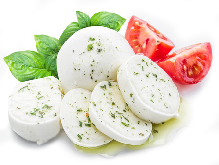 Mozzarella and tomatoes. White background.