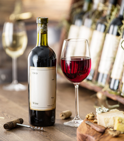 wine testing: Glasses of wine and cheese plate. Wine testing. Stock Photo