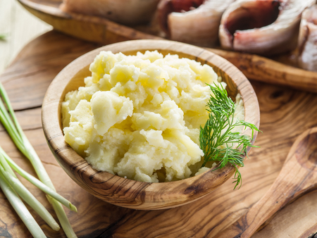 pure de papa: Mashed potatoes in the wooden bowl on the service tray.