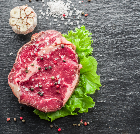 ribeye: Steak Ribeye on the black graphite tray. Stock Photo