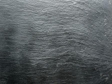 dark grey slate: Graphite plank. Macro picture of natural slate background.