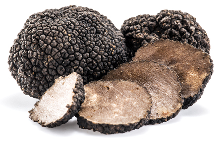 Black truffles isolated on a white background. Banque d'images