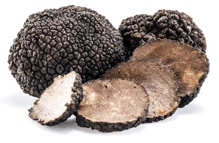 Black truffles isolated on a white background. Archivio Fotografico