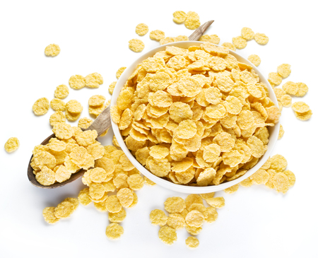 cornflakes: Cornflakes cereal on a white bowl. Morning breakfast.