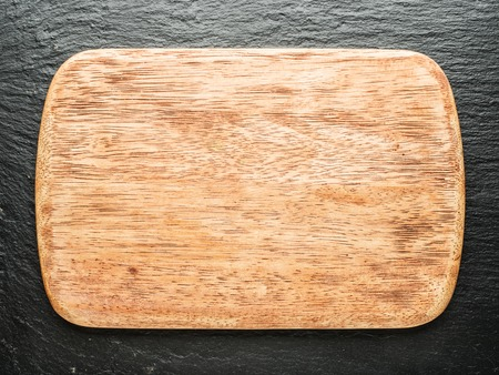graphite: Empty chopping wooden board on the graphite background. Stock Photo