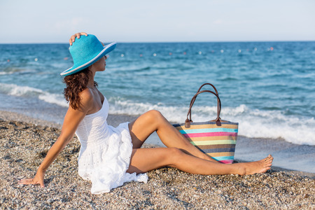 escapism: Woman relaxing at the seaside. Stock Photo