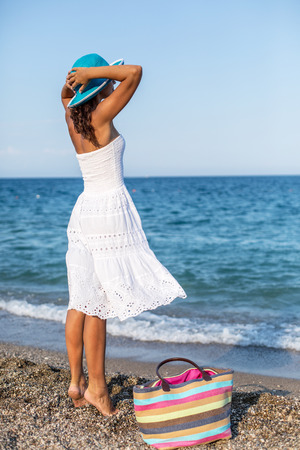 summer holidays: Woman relaxing at the seaside. Stock Photo
