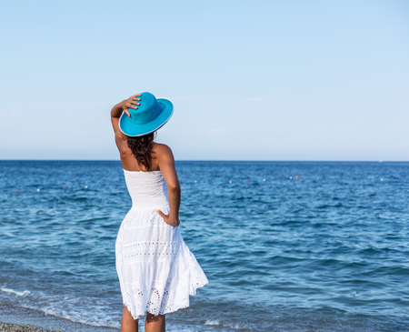 seaside: Woman relaxing at the seaside. Stock Photo