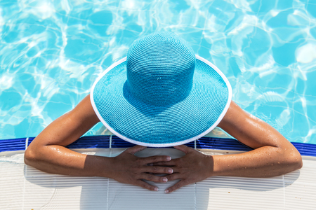 sun hat: Woman in sun hat in the swimming pool. Top view.