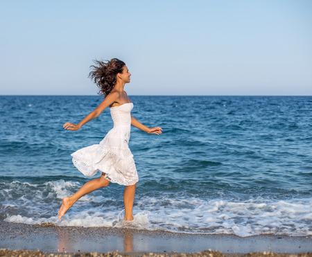woman running: Woman running along the beach.