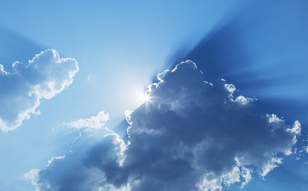 slanting: Sun slanting among from white clouds. Nature background. Stock Photo