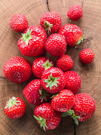 crop harvest: Strawberries on the old wooden board.
