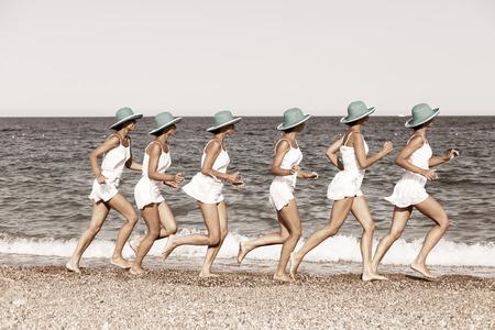 multiple exposure: Woman running on the beach. Multiple exposure shot. Stock Photo