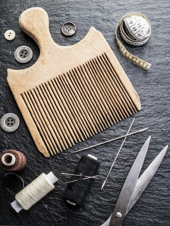 craftsmanship: Sewing and knitting tools on the dark grey background. Stock Photo