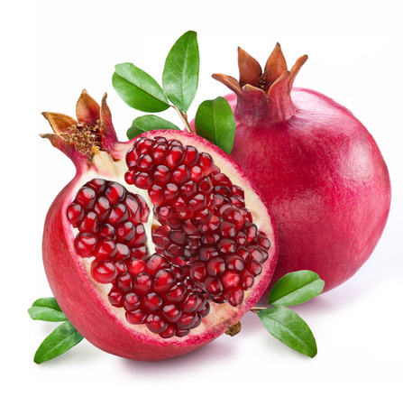 Pomegranate fruit with green leaves on the white background. Reklamní fotografie