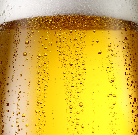 close to: Misted glass of beer. Close up shot.