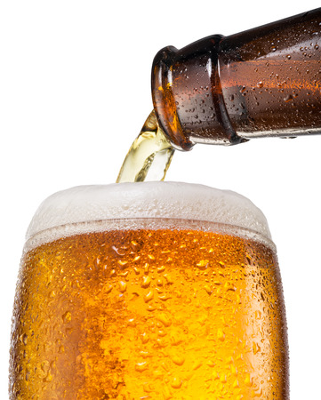 objects with clipping paths: The process of pouring beer into the glass. File contains clipping paths. Stock Photo