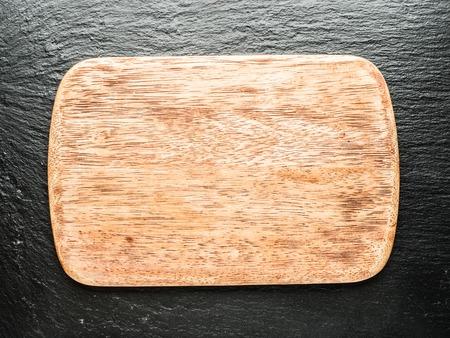 grafito: Vaciar la tabla de cortar madera en el fondo de grafito.
