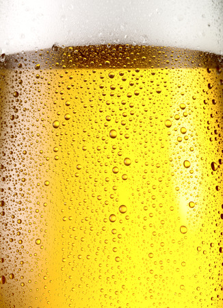 misted: Misted glass of beer. Close up shot.