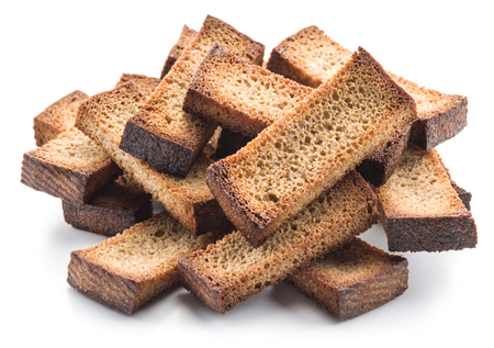 croutons: Bread croutons isolated on a white background. Stock Photo
