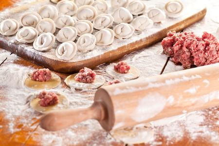 pierogi: Dumplings. Uncooked on the wooden desk.