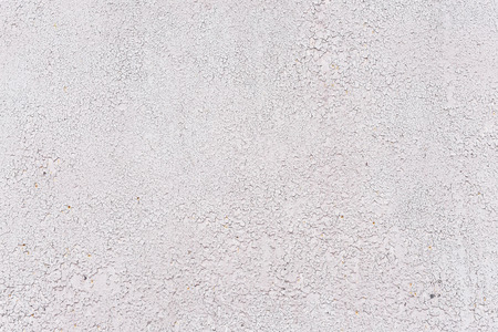 crackles: Crackles of paint on the old grey wall.
