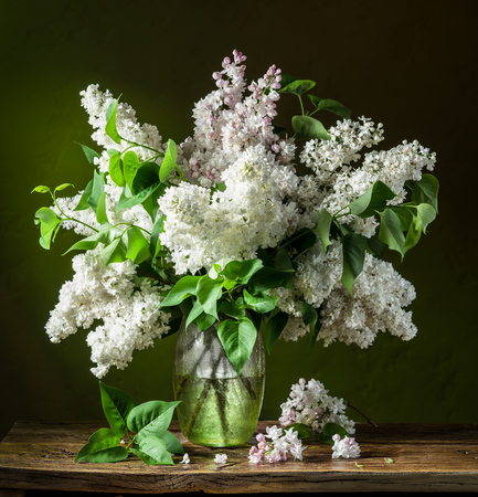 flower of life: Lilac bouquet on the wooden table.