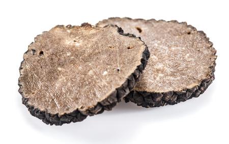white truffle: Slices of black summer truffle on a white background.