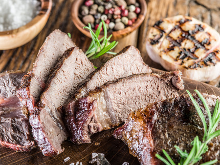 ribeye: Steak Ribeye with spices on the wooden tray. Stock Photo