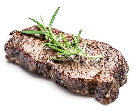 ribeye: Steak Ribeye with spices on the white background.