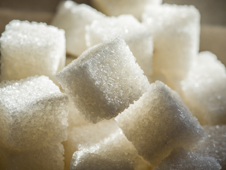 high calorie foods: Close up shot of white refinery sugar.
