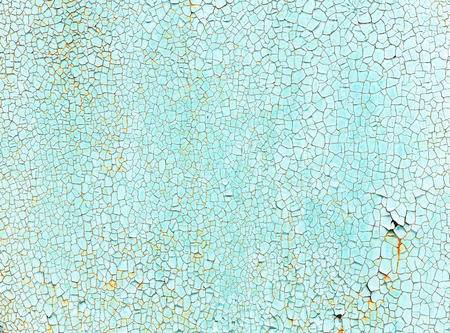 crackles: Crackles of paint on the old green wall. Stock Photo