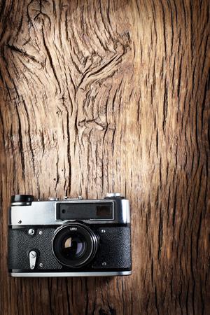 rangefinder: Old rangefinder camera on the old wooden table. Stock Photo