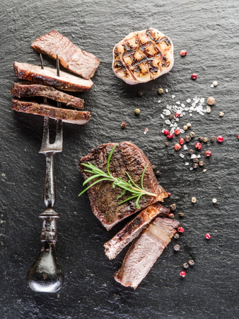 ribeye: Steak Ribeye with spices on the graphite board.