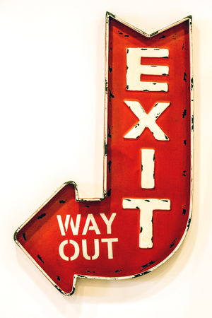 Exit sign. Red arrow sign on the white background. Imagens