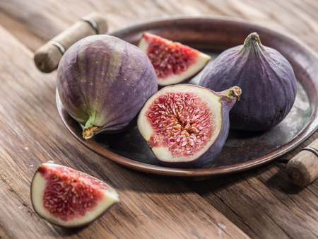 ripe: Ripe fig fruits on the wooden table.
