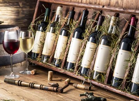 wineries: Wine bottles on the wooden shelf. Stock Photo