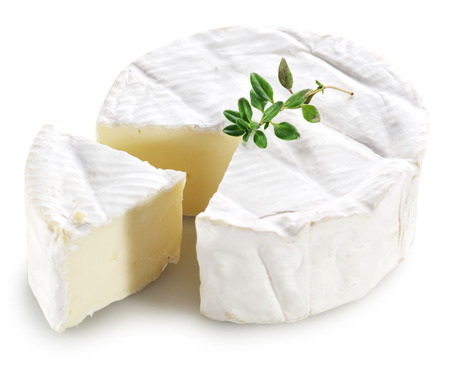 thyme: Camembert cheese isolated on a white background. Stock Photo