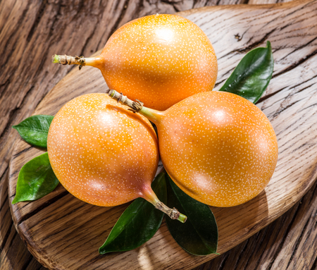 stillife: Granadilla fruits on the wooden table. Stock Photo