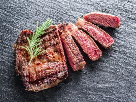black eye: Medium Ribeye steak on the graphite tray. Stock Photo