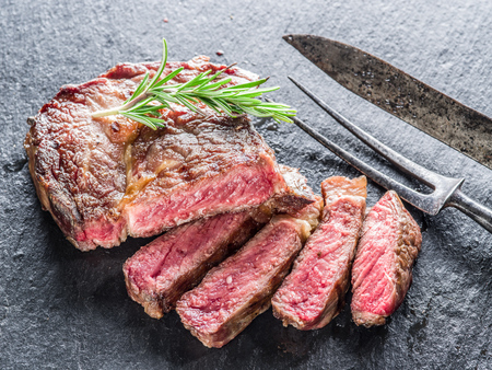 graphite: Medium Ribeye steak on the graphite tray. Stock Photo