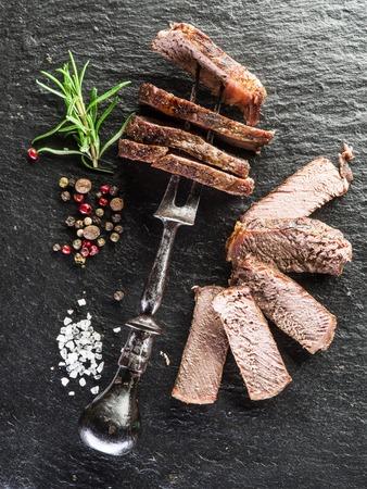 ribeye: Steak Ribeye with spices on the graphite tray. Stock Photo