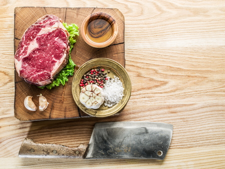 ribeye: Steak Ribeye with spices on the old wooden tray. Stock Photo
