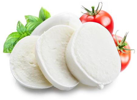 mozzarella cheese: Mozzarella and tomatoes. White background. Stock Photo
