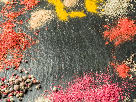 grafit: Assortment of colorful spices on the graphite background.