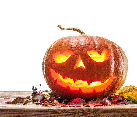 attribute: Grinning pumpkin lantern or jack-o-lantern is one of the symbols of Halloween. Halloween attribute. Stock Photo