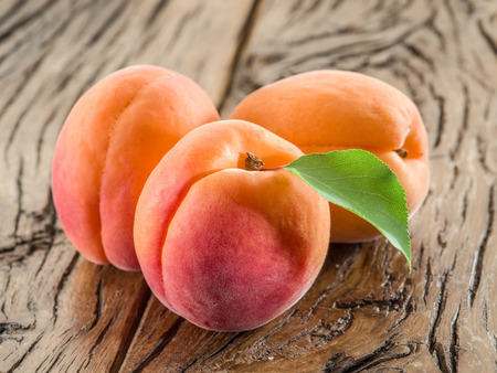 Apricots on the old wooden table. Stock Photo