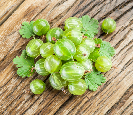 gooseberries: Gooseberries on the wooden table.